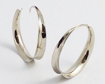 White gold hoop earrings, endless hoops.