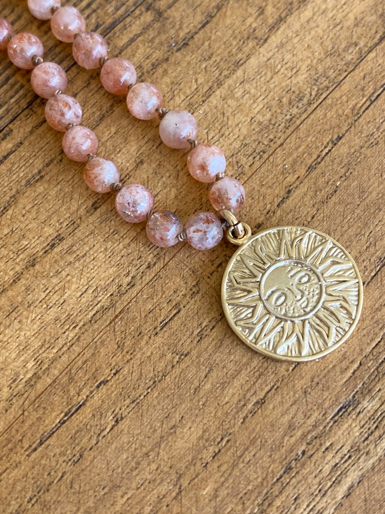 Sun pendant necklace on hand knotted silk with lepidocrocite strawberry-orange stones.