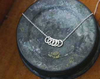 5 ring necklace.