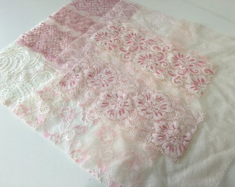 assortment of various smaller sheer lingerie tulle lace / mesh swatches — pink / ivory — different sizes and patterns