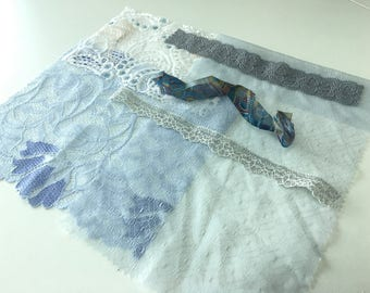 assortment of various smaller sheer lingerie tulle lace / mesh swatches — light blue / grey / silver — different sizes and patterns