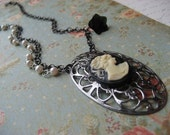 Aberdeen (necklace with vintage silver filigree pendant with black cameo, gunmetal chain, white pearls and black flower)