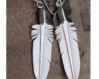 small white hand carved leather feather