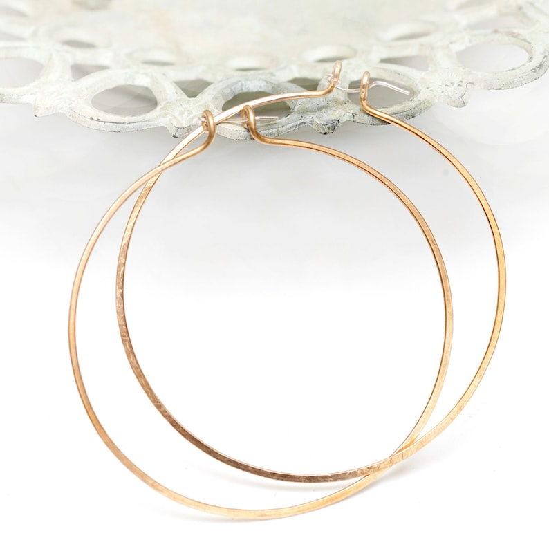 xtra large 3.5 inch hand hammered bronze hoop earrings with image 0