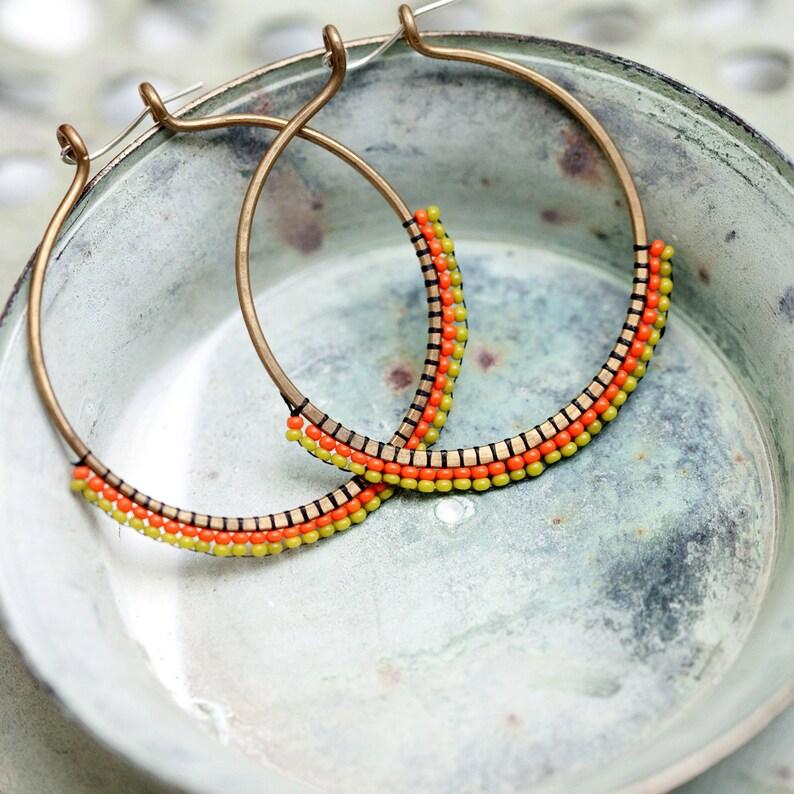 orange and olive seed  bead bronze hoop earrings image 0