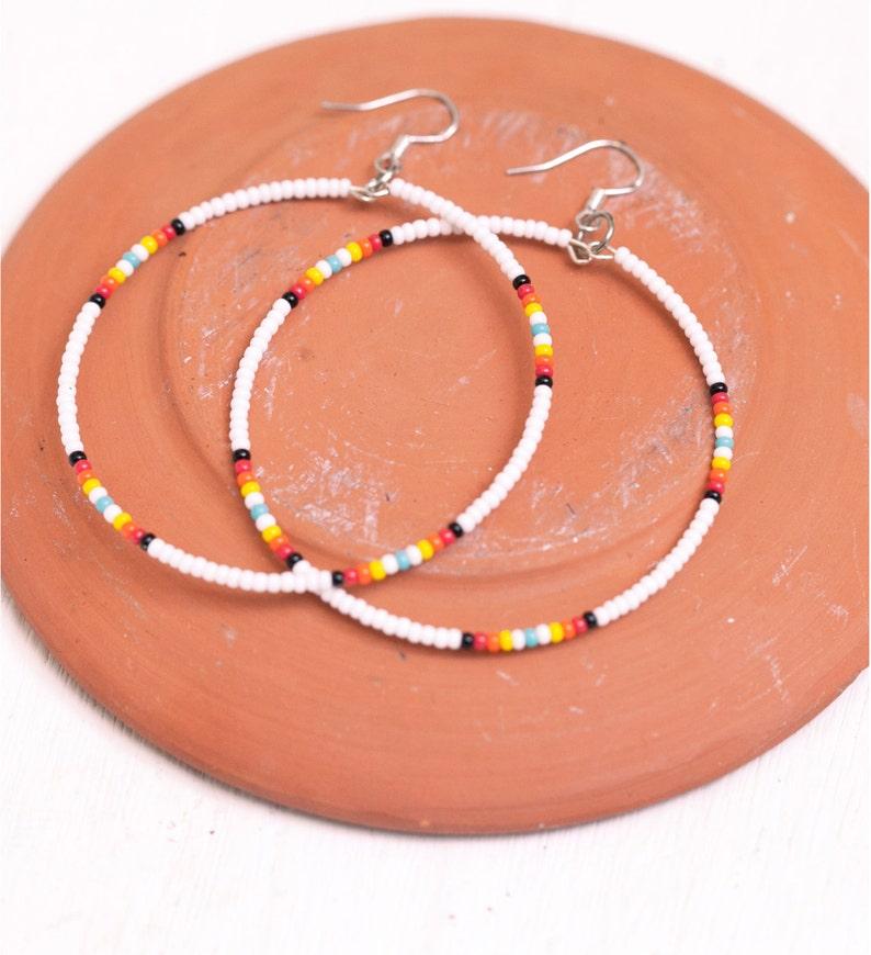 white seed bead hoop earrings image 0