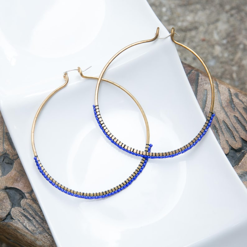 2.5 inch Hand hammered bronze hoops with cobalt blue beading image 0