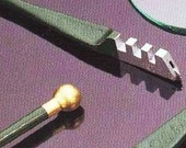 Fletcher Glass Cutter. Inexpensive way for cutting Clear Microscope Glass. Dip into any oil, score (scratch) then break.