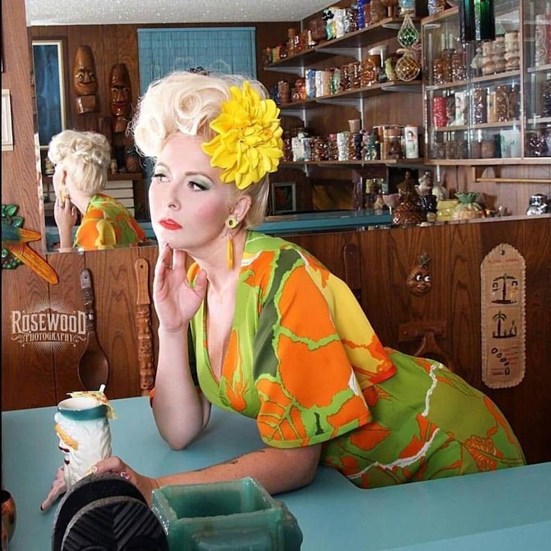 1940s Hair Snoods- Buy, Knit, Crochet or Sew a Snood     Yellow Dahlia Hair Clip Yellow Hair Flower $10.99 AT vintagedancer.com