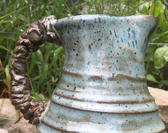 ceramic pitcher in blue and brown