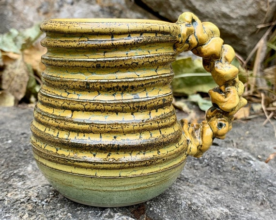 small ceramic mug golden yellow, black, and melon green