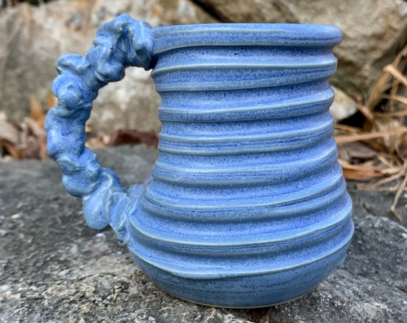 small ceramic mug in bright blue