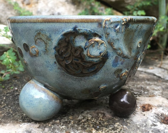 small ceramic bowl with textured molecular motif in slate blue and black
