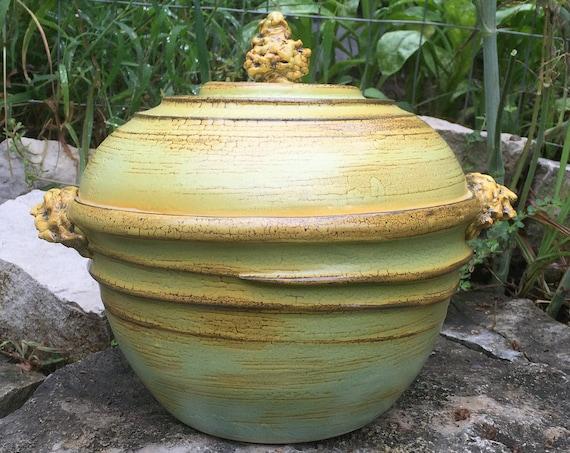 ceramic casserole dish in melon green, golden yellow, and black