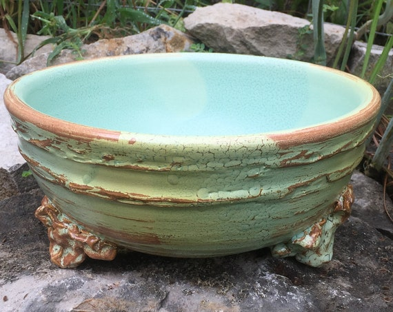 large ceramic bowl in melon green and brown