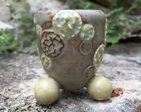ceramic tasting cup or shot glass in olive, beige, and brown with textured molecular motif