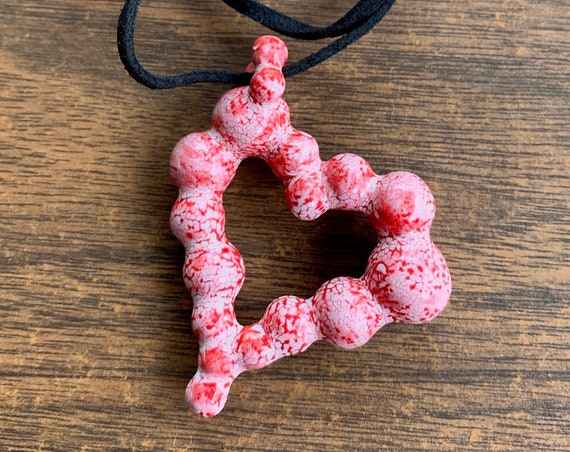 ceramic many ball heart pendant in neon red and white crackle