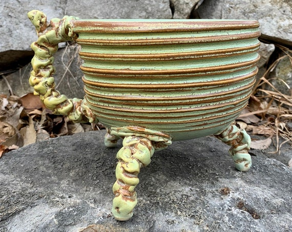 handled serving bowl in melon green and brown