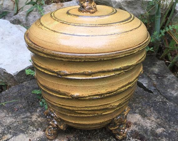 ceramic lidded vessel in golden beige and black