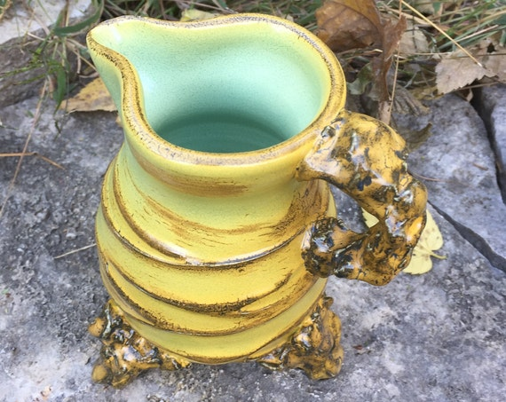 small ceramic pitcher in golden yellow, beige and pale green