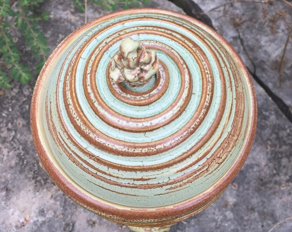 ceramic lidded vessel in melon green and brown