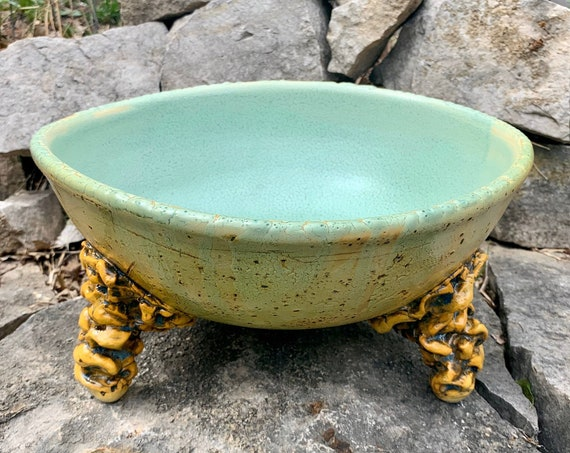 large ceramic bowl in melon green, golden yellow, and black