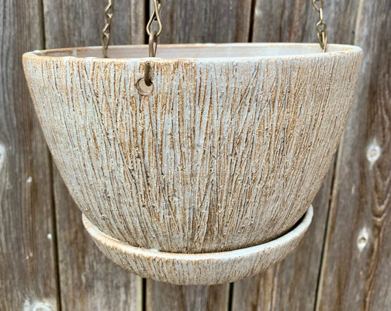 ceramic hanging planter in white, gray, and brown