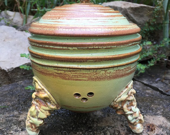 ceramic garlic keeper in melon green and brown