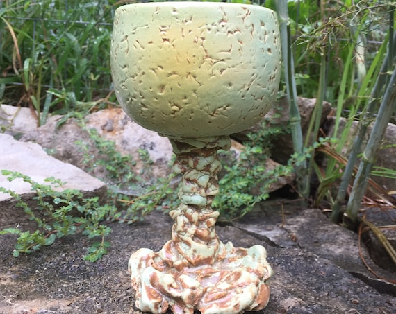 ceramic goblet or wine glass in melon green, golden yellow, and brown
