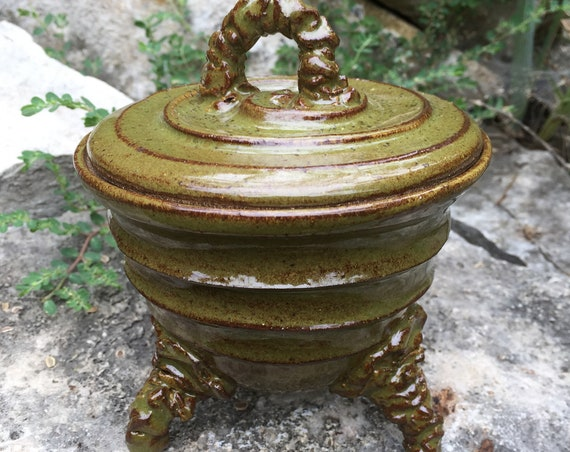 ceramic lidded vessel in olive green and brown