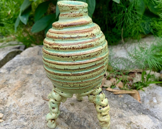 small ceramic bud vase in pale green and warm brown