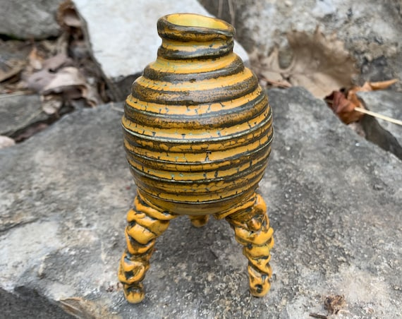 small ceramic bud vase in golden yellow, melon green, and black