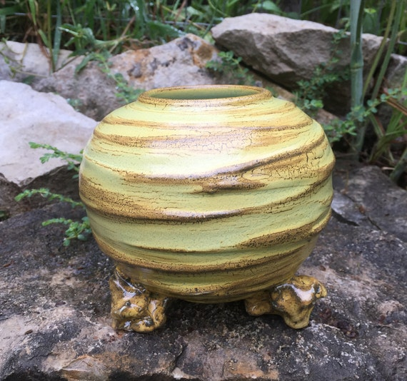 small ceramic vase in golden yellow, black, and melon green