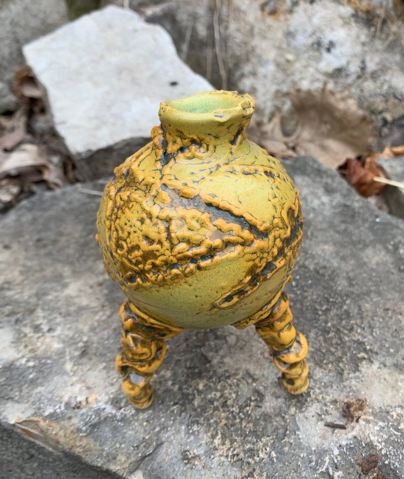 melon green and black small ceramic bud vase in golden yellow
