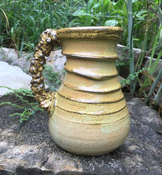 ceramic mug in golden beige, brown, and melon green