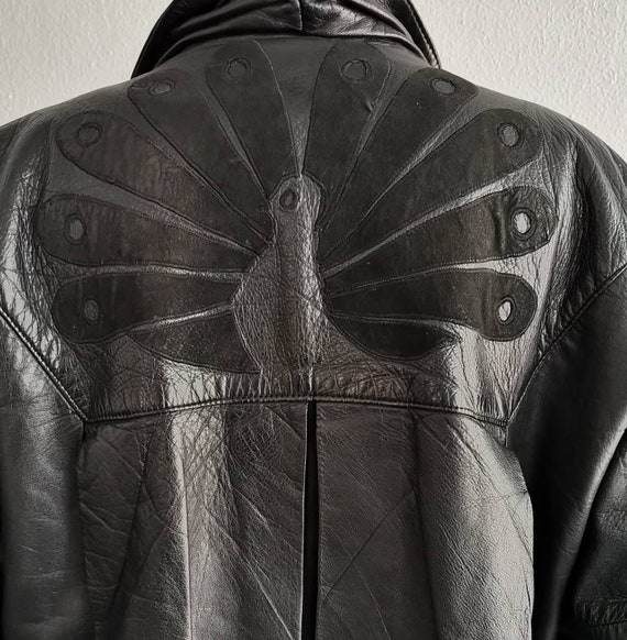 1980's vintage black leather unisex bomber jacket.