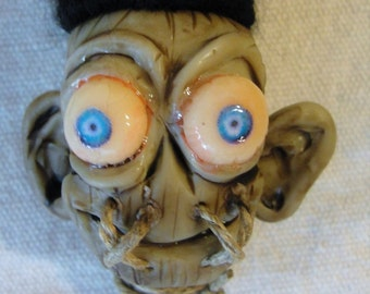 "Shrunkin"" Head on a string"