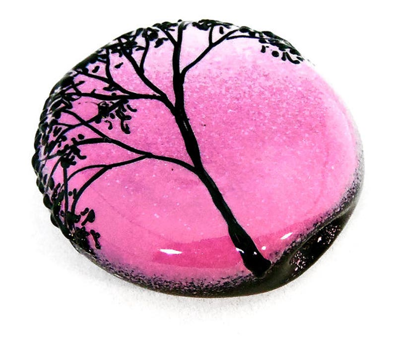 handmade lampwork glass tab bead focal by JC Herrell Tree Silhouette on vibrant pink fade tab Illustration in Glass