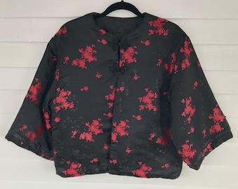 Elegant, yet cosy reversible quilted black satin jacket
