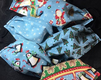 Set of 6 fabric face masks-pleated, elastic loops, Christmas, Santa Claus, trees, snow, penguins, Winter, red, green, blue, FREE SHIPPING