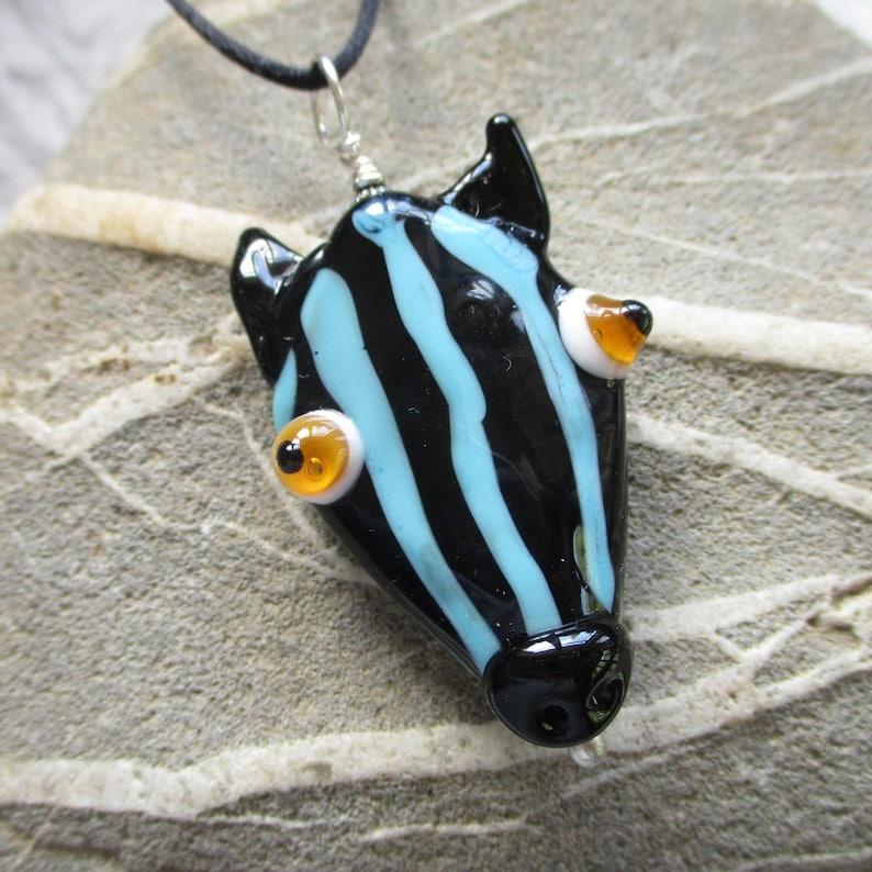 Blue zebra face mask necklace glass bead pendant sculptural image 0