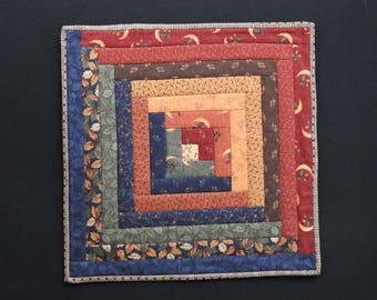 Multi-colored log cabin block quilted wallhanging