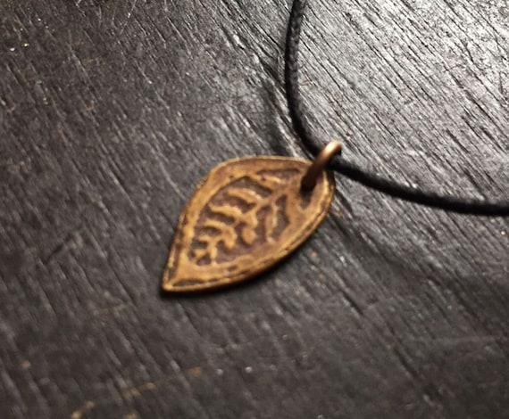 Tiny Brass Reversible Leaf Pendant