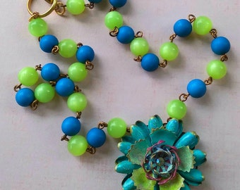 COSMOS, a retro flower Necklace in Light Turquoise and Green from Wendy Baker