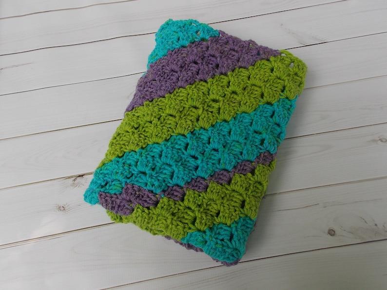 pram stroller car seat aqua crocheted diagonal stripe baby blanket afghan rug purple green multicolored stripes girl