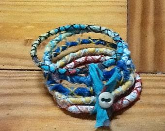 Fiber wrapped bangle bracelet