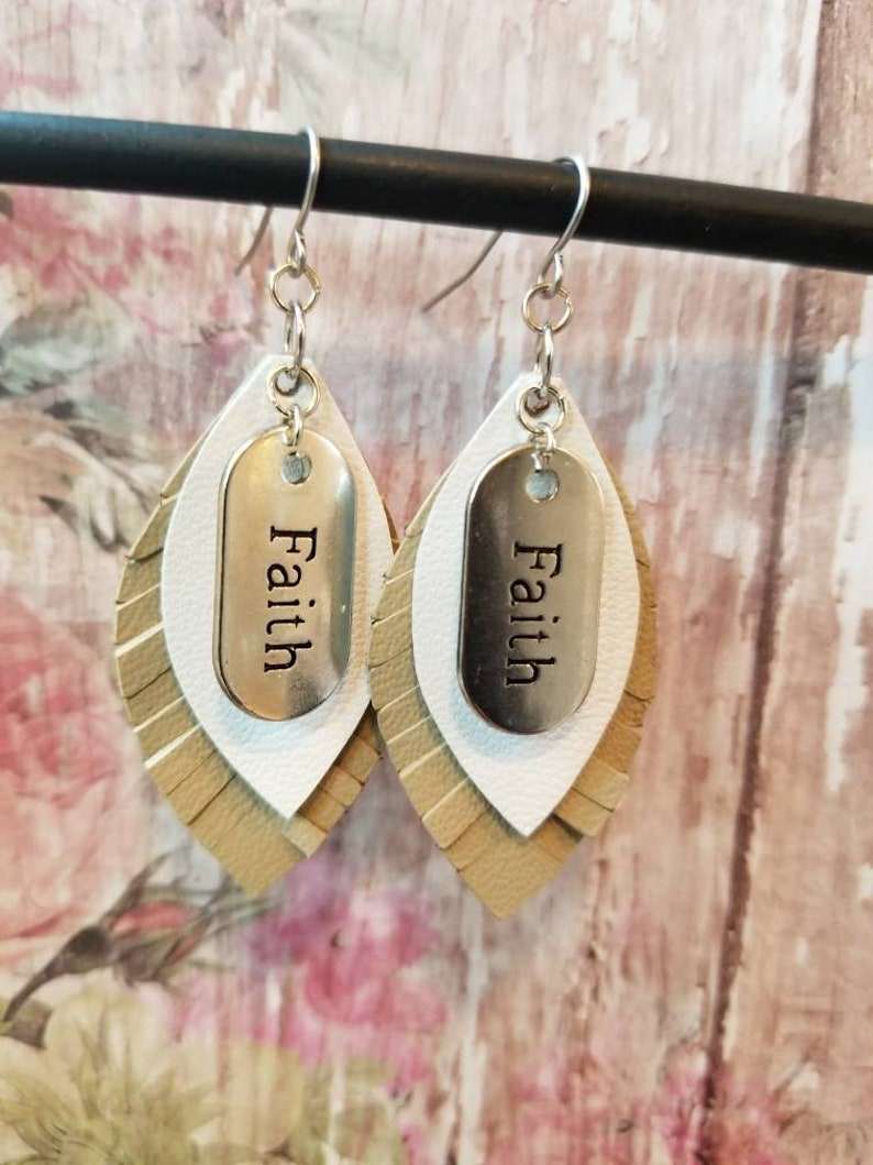Layered leather leaf dangle earrings inspirational fringe feather cut beige leather and white leather with Faith charm tag
