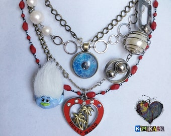 Nuisance Necklace Original Assemblage Statement Necklace Troll Doll (Trolls) & Blue Evil Eye Protection + Hollywood Heart Palm Tree Choker