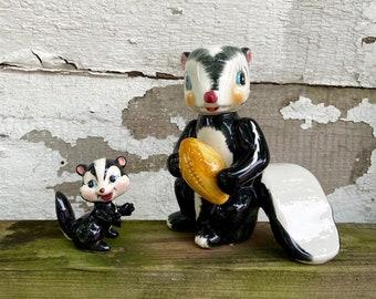 Skunk Figurines with Football (Dad & Child) Set of 2 Vintage