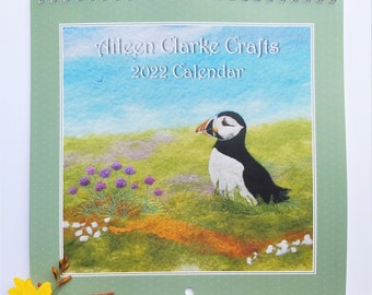 2022 Wall Calendar, Square, Fold Out, Month to View with Prints Featuring Sheep, Cottages, Seascapes, Dolphin, Puffin, Robin and Collie Dog